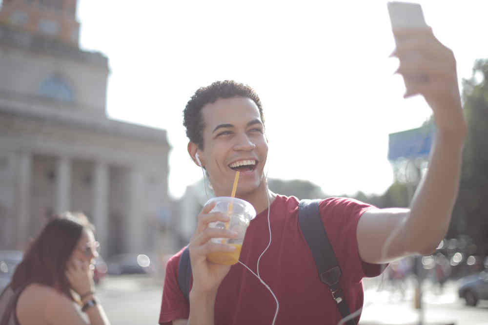 Man accessing the internet via a smart phone